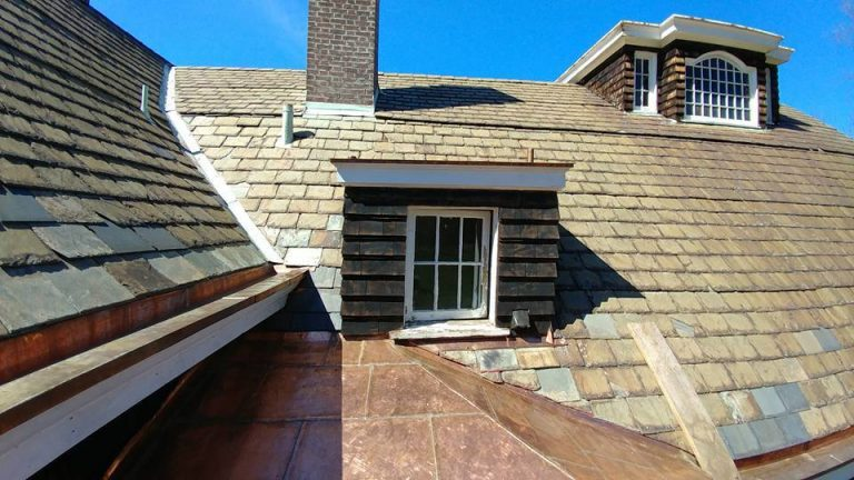 slate roofing mixed with flat seam copper